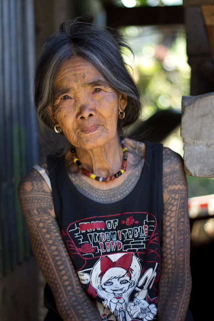 """The Last Kalinga Tattoo Artist"". A fascinating culture of the Igorot people brought me and my girlfriend to Kalinga. Head-hunting ceased decades ago, however, the motifs of Kalinga tattoos and the way they are being tattoed remains the same (charcoal and an orange thorn). We decided to visit this beautiful tribeswoman who is the last Kalinga tattoo artist. After a few days, long hours spent on buses and jeepneys, we were lucky to find a local guide Francis who brought us to Buscalan. We were overwhelmed how hospitable and friendly she is. Her natural beauty and her tattoo tempted me to ask her for a pose outside her dwelling. Location: Buscalan village, Kalinga, North Luzon, Philippines. (Photo and caption by Michal Duchek/National Geographic Traveler Photo Contest)"