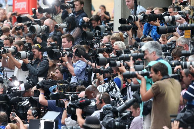 The massed ranks of the media capture the moment the Duke and Duchess of Cambridge leave the Lindo Wing of St Mary's Hospital in London, with their newborn son Tuesday July 23 2013. (Photo by Steve Parsons/AP Photo/PA)