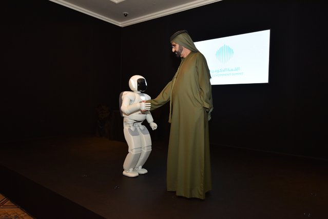 Sheikh Mohammed bin Rashid Al Maktoum, Vice-President and Prime Minister of the United Arab Emirates and ruler of Dubai, shakes hands with a robot as he inaugurates The Museum of Future Government Services, at the Government Summit in Dubai February 8, 2015. (Photo by Reuters/Prime Minister Media Office)