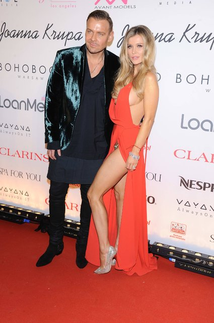 "Model Joanna Krupa with designer Dawid Wolinski at ""Become the Dog Angel Auction"" in Warsaw, Poland on December 1, 2016. (Photo by Marcin Wziontek/Rex Features/Shutterstock)"