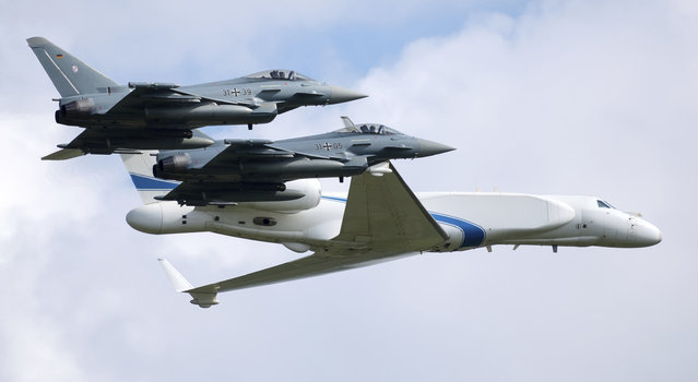 Two German air force Bundeswehr Eurofighters and an Israeli Air Force jet fly in formation over the Fuerstenfeldbruck airbase in commemoration of the 1972 Olympic Games assassination attempt in Fuerstenfeldbruck, Germany, Tuesday, August 18, 2020. The attempt to rescue the hostages failed at the airbase in Fuerstenfeldbruck in 1972and the hostages perished. It is the Israeli Air Force's first time conducting joint air combat exercises in Germany. (Photo by Sven Hoppe/dpa via AP Photo)