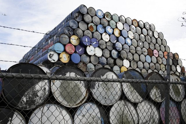 Used oil barrels are stacked at a storage facility in Seattle, Washington February 12, 2015. (Photo by Jason Redmond/Reuters)