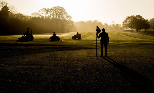 Course manager Mark Murphy and his team of greenkeepers prepare the Tullamore Golf Club in County Offaly, Ireland for its re-opening to the public on April 26, 2021. (Photo by James Crombie/INPHO/Rex Features/Shutterstock)
