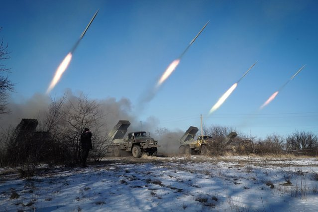 """Pro-Russian rebels stationed in the eastern Ukrainian city of Gorlivka, Donetsk region, launch missiles from Grad launch vehicles on February 18, 2015. Ukrainian troops pulled out of the hotspot eastern town of Debaltseve after it was stormed by pro-Russian rebels in what the EU said was a """"clear violation"""" of an internationally-backed truce. (Photo by Andrey Borodulin/AFP Photo)"""