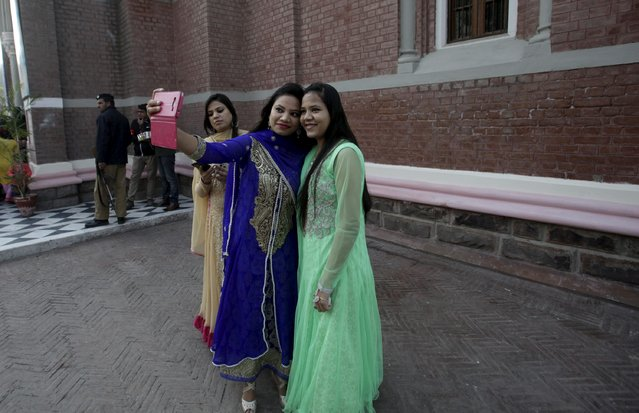 Girls take a selfie after attending a mass on Christmas day at Cathedral Church in Lahore, Pakistan, December 25, 2015. (Photo by Mohsin Raza/Reuters)