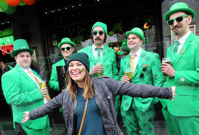 Revellers pose for pictures as they take part in the St Patrick's Day Parade in Dublin, Ireland, on March 17, 2015. (Photo by Paul Faith/AFP Photo)