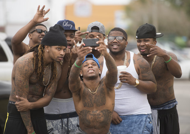 The group Stepp Chyld from Atlanta, Georgia, takes photos during spring break festivities in Panama City Beach, Florida March 12, 2015. (Photo by Michael Spooneybarger/Reuters)