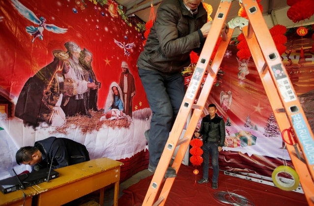 Villagers prepare for a performance on the Christmas Eve outside a Catholic church on the outskirts of Taiyuan, North China's Shanxi province, China December 23, 2016. (Photo by Jason Lee/Reuters)