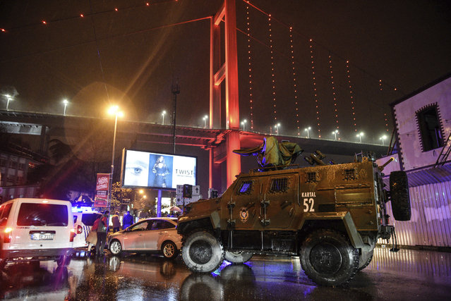 A police armoured vehicle blocks the road leading to the scene of an attack in Istanbul, early Sunday, January 1, 2017. Private NTV television said more than one assailant may have been involved in the attack. The attacker or attackers are believed to have entered the nightclub in Istanbul's Ortakoy district disguised as Santa Claus, the station reported. (Photo by AP Photo)