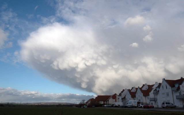 """Clouds hang over a housing complex in Erfurt, eastern Germany, as stormy weather hits the country on March 31, 2015. Storm front """"Niklas"""" sweeping over the whole country reaches a speed of 140 kilometers per hour, according to meteorologists. (Photo by Sebastian Kahnert/AFP Photo/DPA)"""
