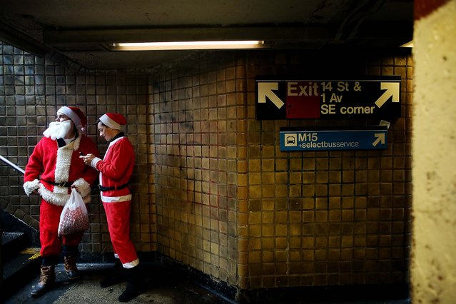 Dave Ruiz and Cody Sienkiewicz, who came from Long Island and Massachusetts respectively, look to join up with the crowd for SantaCon 2013 in  the East Village neighborhood of New York. The costumed pub crawl has garnered a reputation as a hard-drinking and exceedingly chaotic affairr. (Photo by Kirsten Luce/The New York Times)