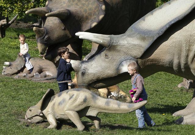 Children visit the World of Dinosaurs exhibition at Pechersk Landscape Park in Kiev, Ukraine, September 10, 2010. (Photo by Gleb Garanich/Reuters)