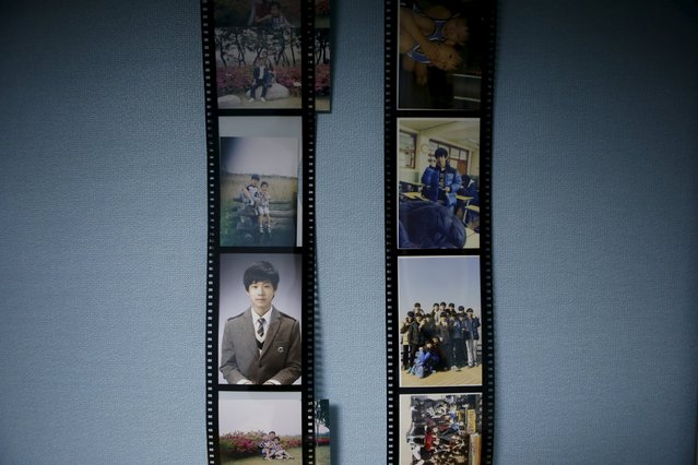 Pictures hang in the bedroom of Jung Hwi-beom, a high school student who died in the Sewol ferry disaster, in Ansan April 7, 2015. His dream was to be a car designer. (Photo by Kim Hong-Ji/Reuters)