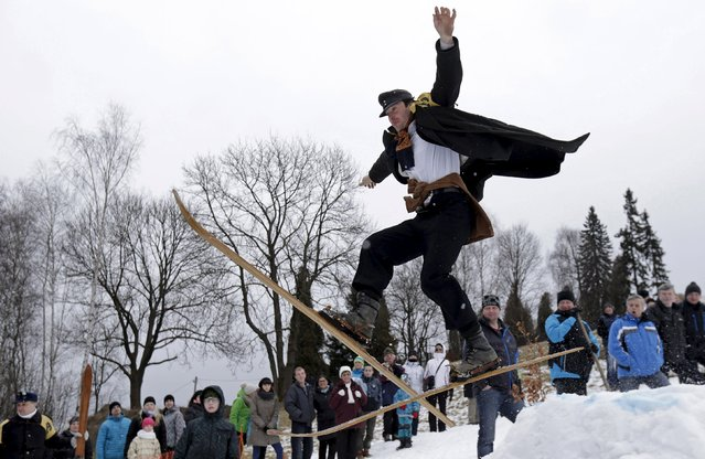 A participant jumps on vintage skis during a traditional historical ski race in the northern Bohemian town of Smrzovka, Czech Republic, February 20, 2016. (Photo by David W. Cerny/Reuters)