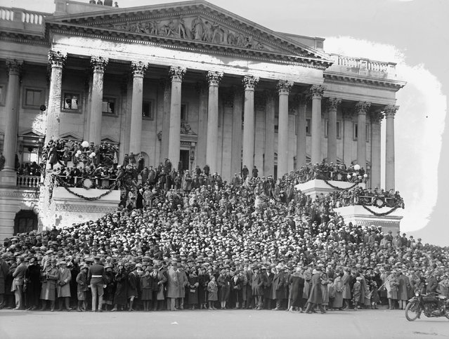 Crowds gathered at the inauguration of Calvin Coolidge in Washington, D.C., U.S. in 1925, the first to be broadcast on national radio. Loudspeakers and microphones on the inaugural platform also allowed those in attendance to listen in. (Photo by Reuters/Library of Congress)