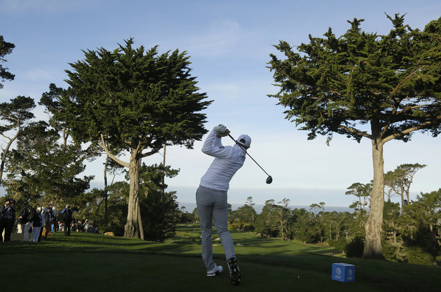 Dustin Johnson hits from the first tee of the Monterey Peninsula Country Club Shore Course during the first round of the AT&T Pebble Beach National Pro-Am golf tournament Thursday, February 7, 2019, in Pebble Beach, Calif. (Photo by Eric Risberg/AP Photo)