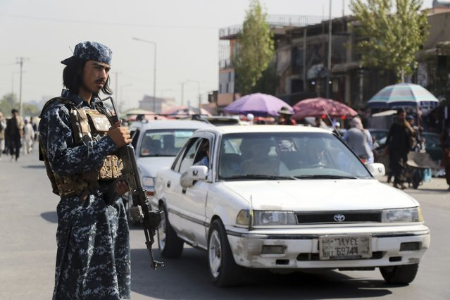 Taliban fighter stand guards in the city of Kabul, Afghanistan, Saturday, September 4, 2021. (Photo by Wali Sabawoon/AP Photo)