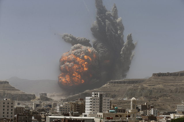 Smoke rises during an air strike on an army weapons depot on a mountain overlooking Sanaa, April 20, 2015. (Photo by Khaled Abdullah/Reuters)