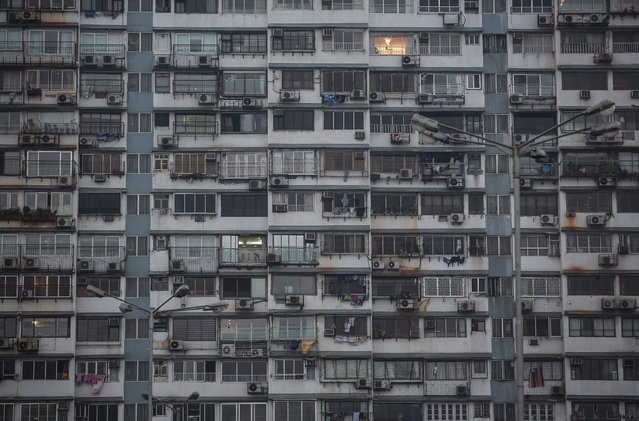 Windows of a high rise residential building are pictured in south Mumbai January 27, 2015. The cost for buying a 900 square feet (83.5 square meters) two-bedroom apartment in the seen building is around 70,000 Indian rupees ($ 1,119) per square feet or 63,000,000 Indian rupees ($ 1.07 million). The rent for an apartment in the same building is around 110,000 Indian rupees ($ 1,760) per month. (Photo by Danish Siddiqui/Reuters)