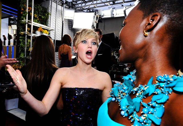 Jennifer Lawrence and Lupita Nyong'o attend the 20th annual Screen Actors Guild Awards. (Photo by Kevork Djansezian/Getty Images)