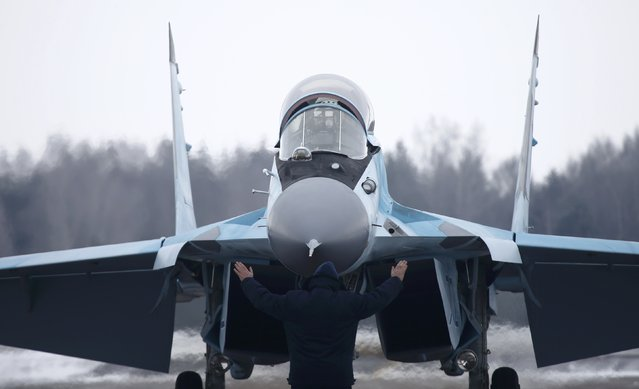 A new multi-role Russian MiG-35 fighter lands during its international presentation at the MiG plant in Lukhovitsy outside Moscow, Russia January 27, 2017. (Photo by Maxim Shemetov/Reuters)