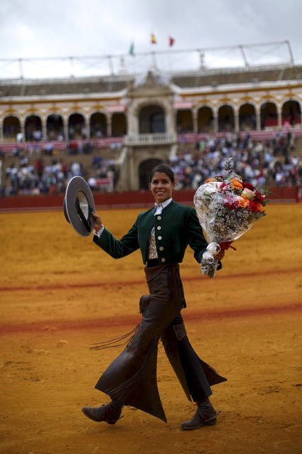 French rejoneadora (mounted bullfighter) Lea Vicens celebrates her performance during a bullfight at The Maestranza bullring in the Andalusian capital of Seville, southern Spain April 26, 2015. (Photo by Marcelo del Pozo/Reuters)