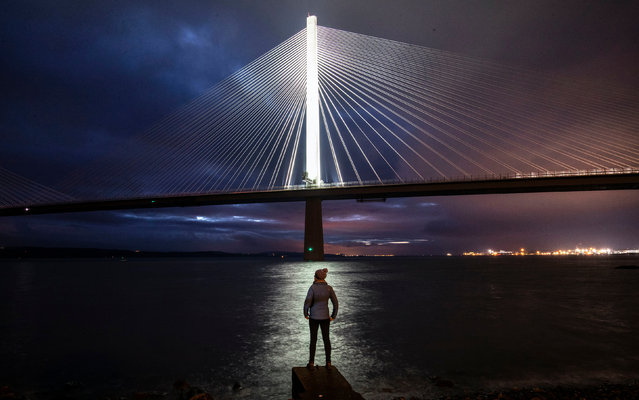 The testing of new lighting on the Queensferry Crossing which spans the Firth of Forth in Edinburgh, Scotland on December 26, 2018. Once fully operational it will include uplighting for each of the main towers and strip lighting along the deck edge of the bridge. (Photo by Jane Barlow/PA Wire Press Association)