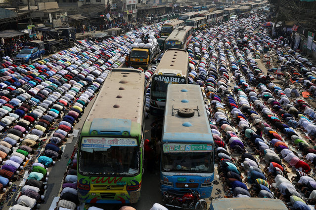 Vehicles are stuck as Muslims perform Friday prayer on the road during the Biswa Ijtema in Dhaka, Bangladesh on February 15, 2019. (Photo by Mohammad Ponir Hossain/Reuters)