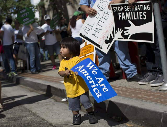 Evan Colorado, who is one-and-a-half, holds a sign during a May Day protest in Los Angeles, California May 1, 2015. (Photo by Mario Anzuoni/Reuters)