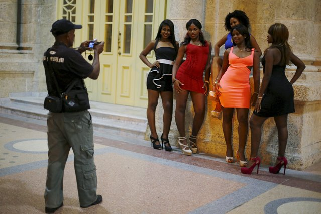 Women pose for a picture at Havana city, Cuba, March 17, 2016. Obama arrives in Havana on Sunday for a historic visit that seals a rapprochement he and Cuban President Raul Castro agreed in December 2014 after 18 months of secret negotiations. (Photo by Ivan Alvarado/Reuters)