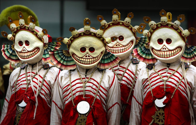"Monks dressed as Tibetan Buddhism characters attend a religious ceremony, known as ""Da Gui"" or beating ghost, to celebrate the upcoming Tibetan New Year which starts on March 1 at Yonghegong Lama Temple, in Beijing February 28, 2014. This Tibetan ceremony is held annually at the end of the first lunar month with mask dancing to expel ghosts, according to a press release. (Photo by Jason Lee/Reuters)"