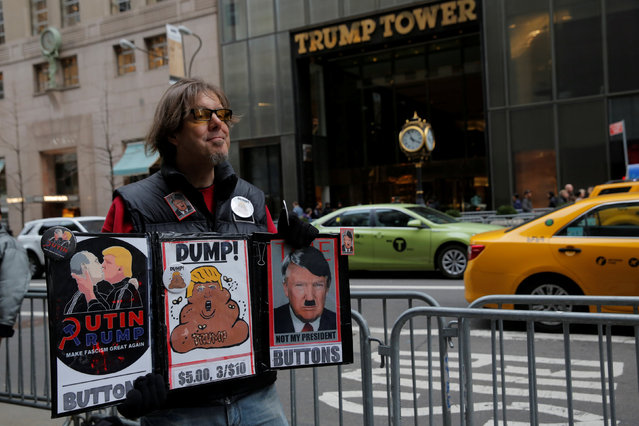 Paul Rossen of New York sells anti- Donald Trump buttons outside Trump Tower on Fifth Avenue in Manhattan, New York City, U.S., February 27, 2017. (Photo by Andrew Kelly/Reuters)