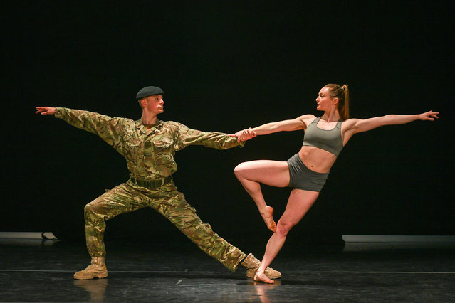 """Serving soldier in the British Army, Trooper Alex Smith, 22, of 1st The Queen's Dragoon Guards, poses with his dance partner, Harriet Elli during rehearsals for a production called """"10 Soldiers"""" by the Rosie Kay dance company about military life on April 2, 2019. (Photo by Ben Birchall/PA Images via Getty Images)"""