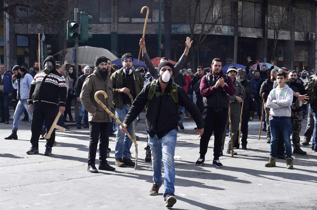 People hold sheperds crook duringa Greek farmer' s protest against higher taxes outside the Agriculture ministry in Athens, on March 8, 2017. (Photo by Louisa Gouliamaki/AFP Photo)