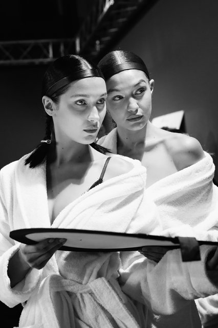 Bella Hadid and Gigi Hadid prepare backstage before the  H&M Studio show as part of the Paris Fashion Week on March 1, 2017 in Paris, France. (Photo by Vittorio Zunino Celotto/Getty Images)