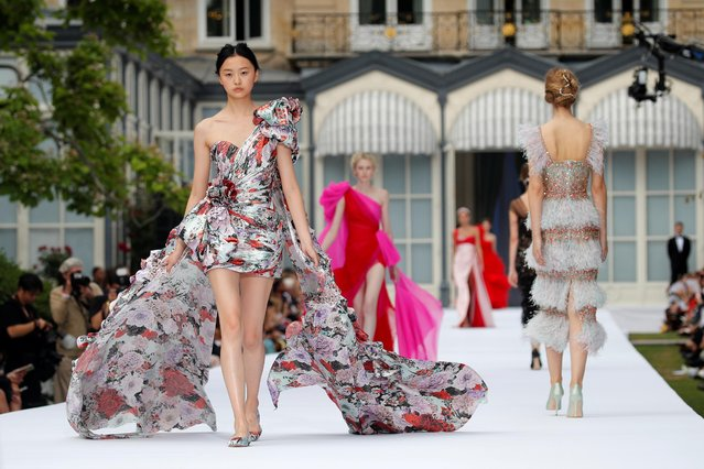 Models present creations by designers Tamara Ralph and Michael Russo as part of their Haute Couture Fall/Winter 2019/20 collection show for fashion house Ralph & Russo in Paris, France, July 1, 2019. (Photo by Charles Platiau/Reuters)
