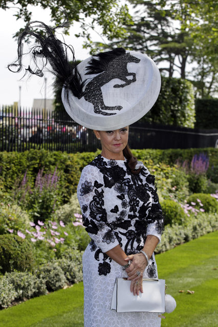 Gail Hayden-Stapf poses for photographers as she arrives for the first day of  Royal Ascot horse racing meet at Ascot, England, Tuesday, June 16, 2015. Royal Ascot is the annual five day horse race meeting that Britain's Queen Elizabeth II attends every day of the event. (AP Photo/Alastair Grant)