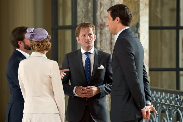 (L to R) Crown Grand Duke Guillaume and Crown Grand Duchess Stephanie of Luxembourg and Prince Pieter-Christiaan of Orange-Nassau chat with Prince Jean-Christophe Napoleon as King Philippe of Belgium invited them at the royal castle of Laken at the occasion of the anniversary of the battle of Waterloo, in Brussels, Belgium June 17, 2015. REUTERS/Eric Vidal