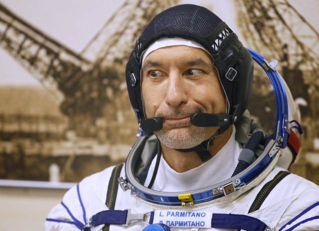Italian astronaut Luca Parmitano, member of the main crew of the expedition to the International Space Station (ISS), gestures, prior to the launch of Soyuz MS-13 space ship at the Russian leased Baikonur cosmodrome, Kazakhstan, Saturday, July 20, 2019. (Photo by Dmitri Lovetsky/AP Photo)