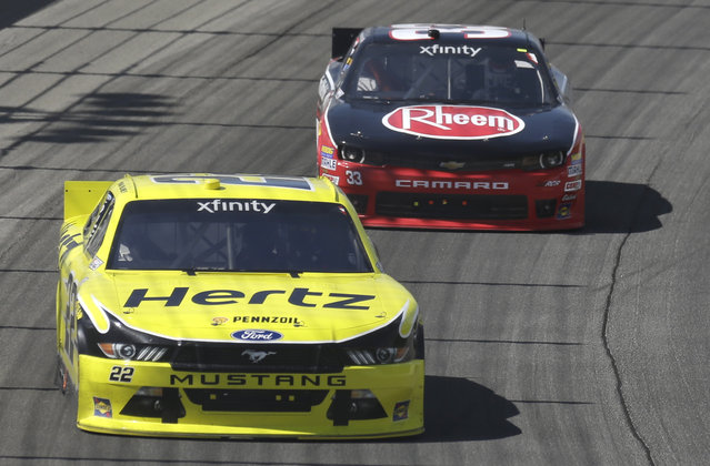 Ryan Blaney (22) drives past Austin Dillon (33) during the NASCAR Xfinity series auto race at Chicagoland Speedway, Sunday, June 21, 2015, in Joliet, Ill. (AP Photo/Nam Y. Huh)