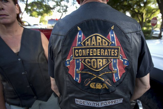 "A biker wears a ""Hard Confederates Core"" vest before a ""Ride for Pride"" event to show support for the Confederate flag in Brandon, Hillsborough County, June 26, 2015. (Photo by Carlo Allegri/Reuters)"