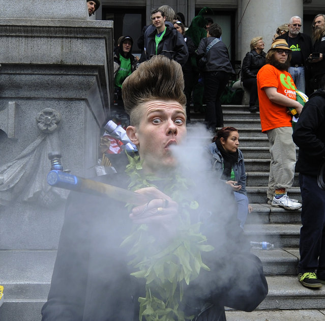 Vancouver B.C. April 20, 2014  Big Day to celebrate as thousand gathered in front of Vancouver Art Gallery to take part in the 420 Marijuana smoke in here  in Vancouver on April 20, 2014. (Photo by Mark van Manen/PNG Staff  Photographer/Ian Austin Province News/Vancouver Sun News & Web  stories)