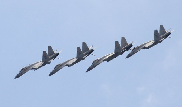 J-11B fighter jets of the Chinese Air Force fly in formation during a training session for the upcoming parade marking the 70th anniversary of the end of World War Two, on the outskirts of Beijing, July 2, 2015. (Photo by Jason Lee/Reuters)