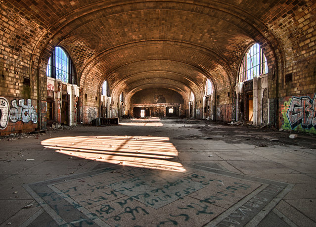Graffiti lines the walls of the main room within the East Central Station of Buffalo, New York. (Photo by Jonny Joo/Barcroft Media)