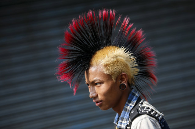 A Myanmar punk wearing a mohawk hairstyle takes part in a punk gathering ahead of the Thingyan water festival in Yangon, Myanmar, 12 April 2017. (Photo by Lynn Bo Bo/EPA)