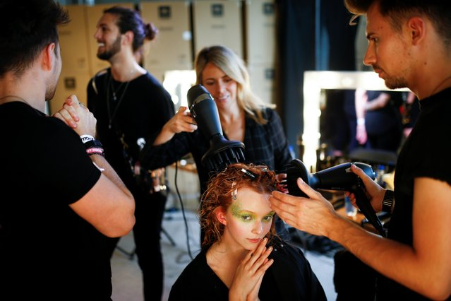 A model prepares ahead of the House of Holland catwalk show during London Fashion Week in London, Britain, September 14, 2019. (Photo by Henry Nicholls/Reuters)