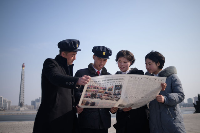 "North Korean students read the Rodong Sinmun newspaper coverage of North Korea's leader Kim Jong Un visiting Vietnam for a summit in Hanoi with US President Donald Trump, on Kim Il Sung square Pyongyang on February 28, 2019. The US-North Korea nuclear summit in Hanoi ended abruptly without a deal, with President Donald Trump saying he had decided to ""walk"" in the face of Kim Jong Un's demands to drop sanctions. (Photo by Kim Won Jin/AFP Photo)"