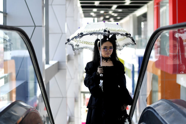 """A cosplay enthusiast takes part in the """"Hijab Cosplay"""" event in Subang Jaya, outside of Kuala Lumpur, on April 29, 2017. The event, the first of its kind in Malaysia, is aimed at giving a platform to hijab- wearing Muslim cosplayers in the country. The term, a contraction of """"costume player"""", indicates the practice of wearing a costume representing a cartoon character or video- games. (Photo by Manan Vatsyayana/AFP Photo)"""