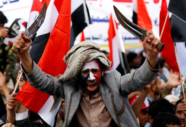 A man waves traditional daggers, or Jambiyas, as he attends with supporters of the Houthi movement and Yemen's former president Ali Abdullah Saleh a rally to mark two years of the military intervention by the Saudi-led coalition, in Sanaa, Yemen March 26, 2017. (Photo by Khaled Abdullah/Reuters)
