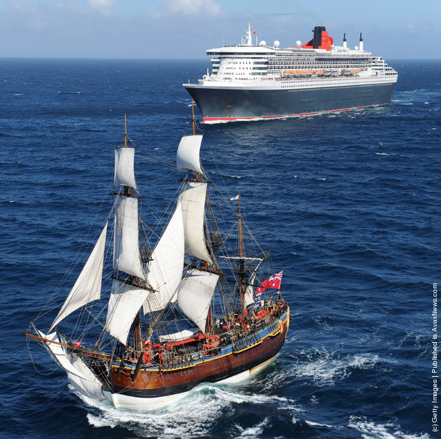 The Queen Mary 2 is saluted by the HMB Endeavour, the replica of Captain James Cook's ship off the coast of Victoria, Australia